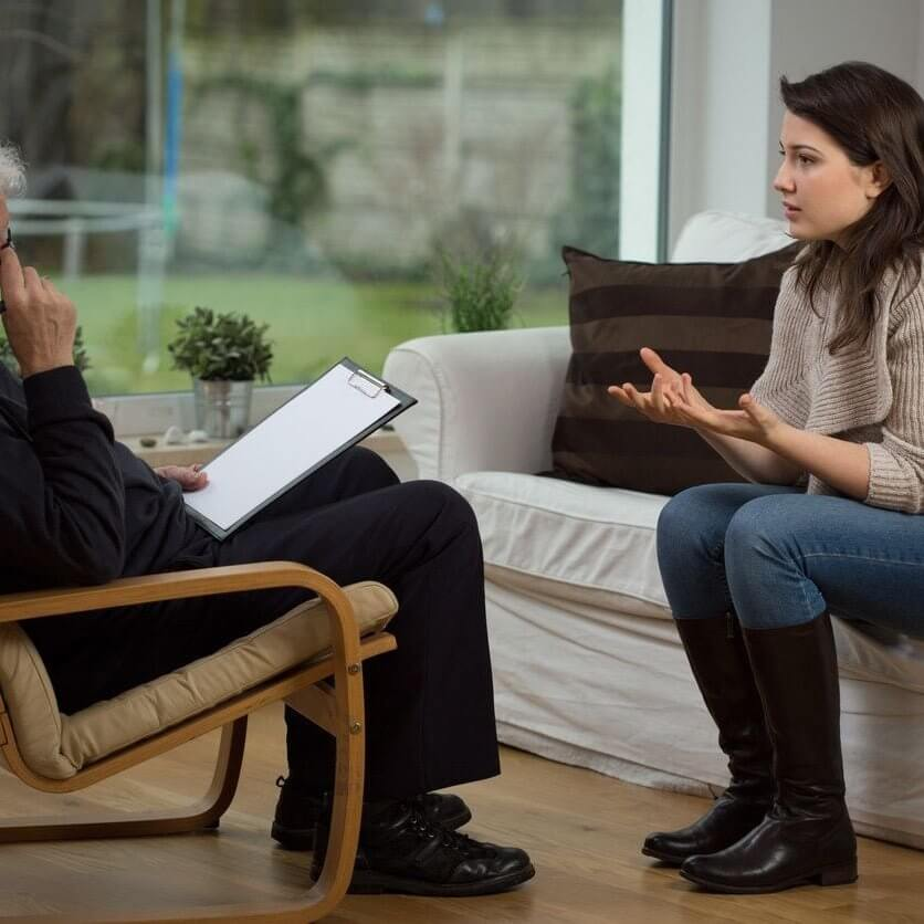 A young women talking to a therapist
